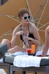 http://img185.imagevenue.com/loc504/th_312841634_Mischa_Barton_Bikini_Candids_on_the_Beach_in_Miami_December_27_2011_260_122_504lo.jpg